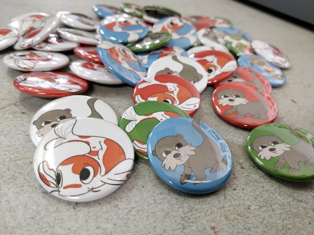 Team Otter and Team Koi buttons